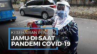 Sambung Hidup di Tengah Corona, Tukang Jamu Gunakan Face Shield Keliling Pasar Baru