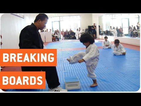 little boy trying to break board in taekwondo the new karate