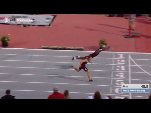 Guy Dives Over The Finish Line