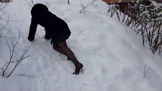 girl in sexy high heels climbs uphill and downhill, fall on high heels, shoes in snow (scene 140)