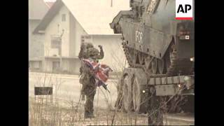 BOSNIA: BRITISH TANKS ARRIVE TO HELP UPHOLD THE PEACE ACCORD