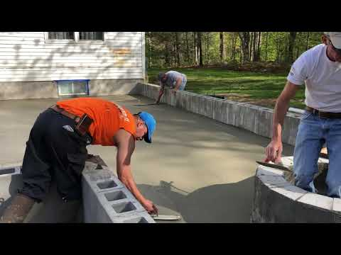 Basement Systems of New York Installing A New Concrete Patio Slab with a Retaining Wall and Stairs