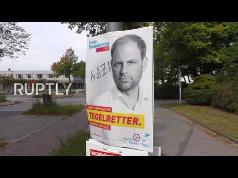 Germany: 'It's time' ... for a pee? Martin Schulz poster plastered on side of Berlin TOILET