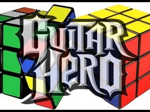 Uber-Geek Solves Two Rubik's Cubes While Playing Guitar Hero