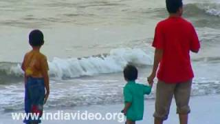 Playing in the surf at Kozhikode beach