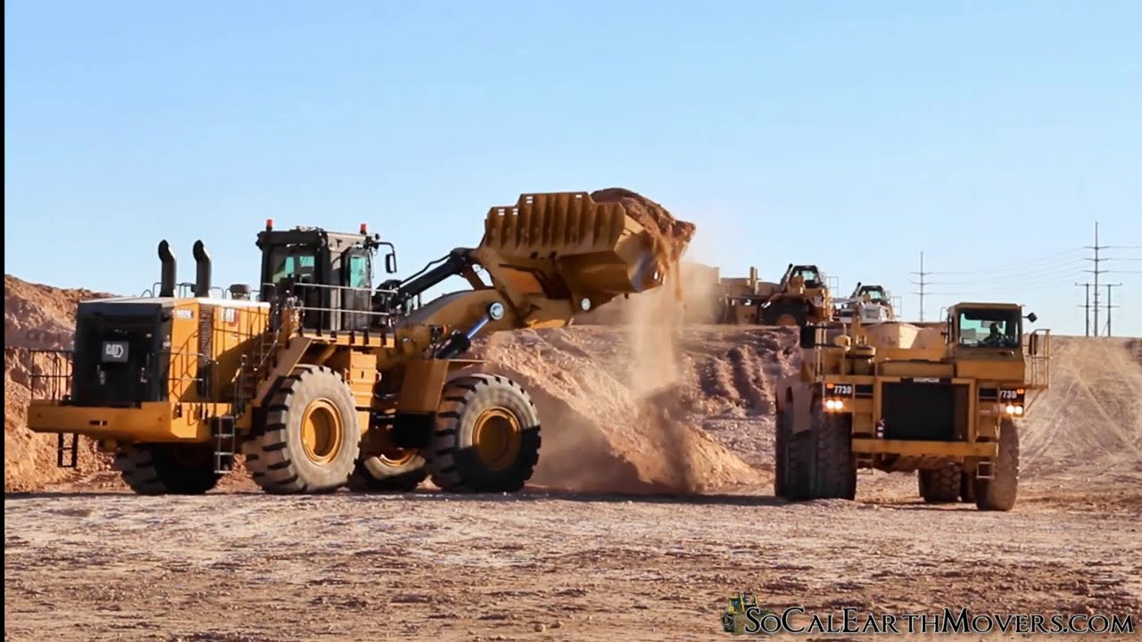 A new CAT 992K loading 773D Athey bottom dumps