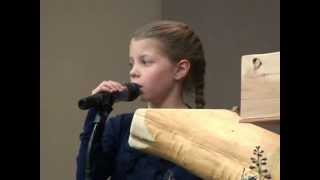 Nine year old sings Amazing Grace at grandfather's funeral