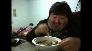 Funny asian man (too happy to eat food)