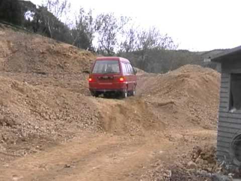 Toyota townace van climbing dirt mound