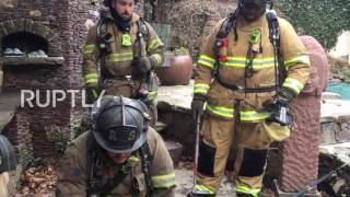 USA: Mouth to mut - DC firefighters resuscitates dog retrieved from burning house