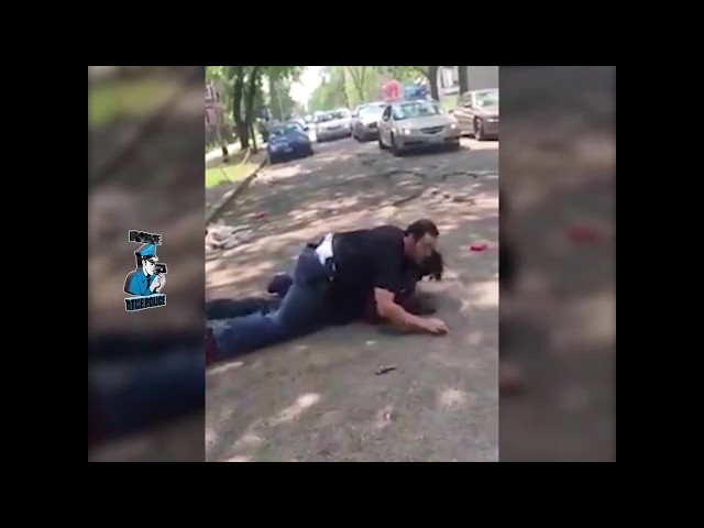 Cop Stomps On Man's Head