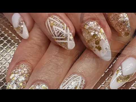 White & Gold Acrylic Almond Nail Design with Freehand Art