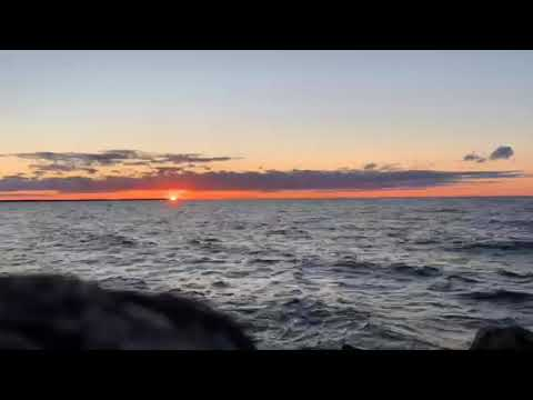 Sunset over Green Bay on west side of park