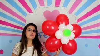 Decoração de balões Neste vídeo você aprende a fazer passo a passo um enfeite em balões no formato de flor para a parede! Faça nas suas festinhas!!! É fácil e fica lindo!!!! www.amofestas.com
