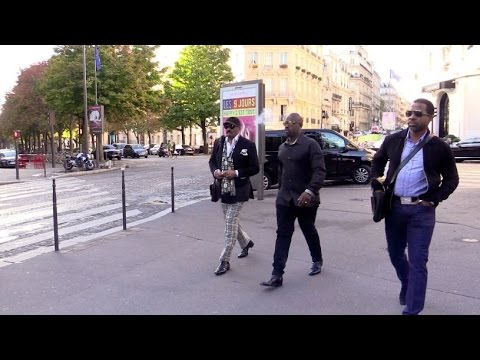 EXCLUSIVE: Steve Harvey and Corey Gamble go for a walk in Paris