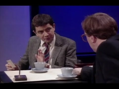 Rowan Atkinson: A headmaster meets with a parent