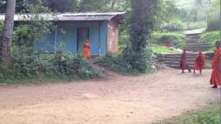 preview picture of video 'Novice monks playing cricket !!!'