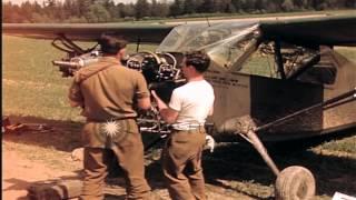 U.S. Army aircraft mechanics repair a Stinson L-5 airplane in Germany HD Stock Footage