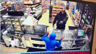 COP WALKS IN ON 7-11 ROBBERY, SHOTS FIRED