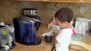 Watching this toddler make coffee for his dad will change everything you think you know about what o