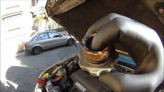 BLOWN HEAD GASKET= MILKY OIL CAP. HOW TO TELL A BLOWN HEAD GASKET ON OIL CAP