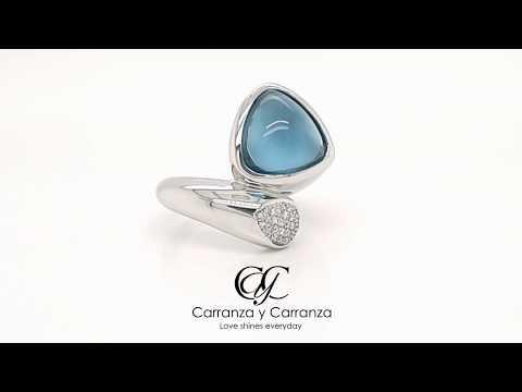 Anillo Breuning colección Balance con topacio azul y diamantes en oro blanco 18k
