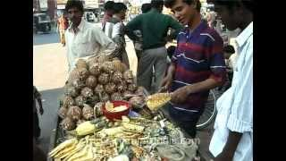Pineapple Seller Slices Fruit For Selling