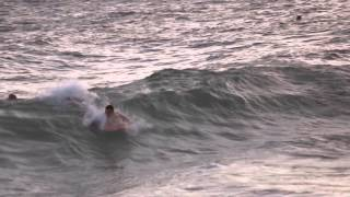 preview picture of video 'Body Boarding During Sunset at Sandy Beach'