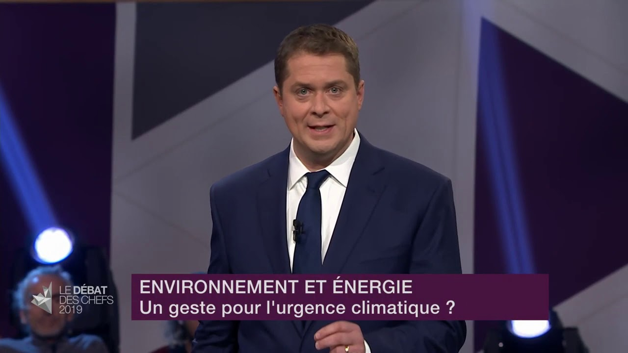 Andrew Scheer answers a question about fighting climate change