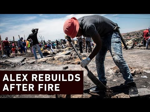 Alex community rebuild homes after fire