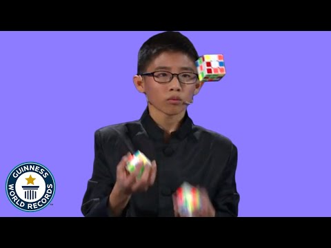 Kid Juggles While Solving Rubik's Cube For Guinness World Records