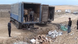 В Шымкенте трактор раздавил почти 39 тысяч бутылок коньяка, водки и пива