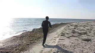 Полицейский из Николаева установил национальный рекорд, пробежав вдоль острова Джарылгач