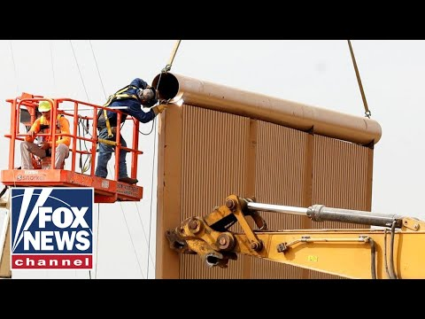 Critics sound alarm after video shows men climbing Trump's border wall