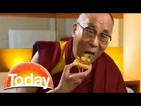Dalai Lama starts eating pizza during interview