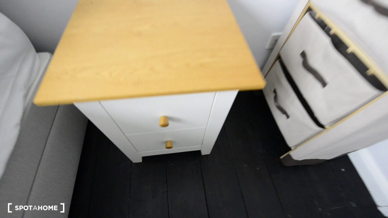 Decorated room with chest of drawers in 4-bedroom flat, Whitechapel