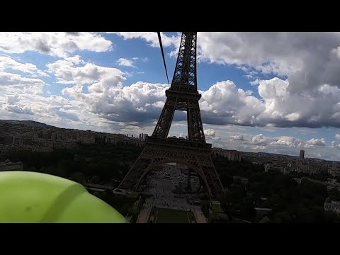 Volunteers jumped off a platform hanging from the second floor of the Eiffel Tower on Tuesday for a thrilling ride down an 2,600 foot zipline. (May 28)