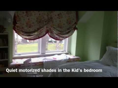 The finished product of our quiet, low voltage motorized shades. Installed throughout the home, this video shows the operation in the kid's bedroom. The low voltage shades are not much bigger than traditional manually operated shades and have been fitted to a standard window opening and finished with drapery.