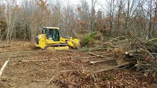 CAT 953D clearing woods