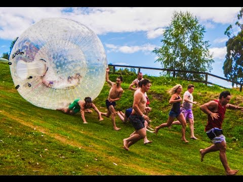 Watching People Get Run Over By A Giant Rolling Bubble Ball Is So Funny