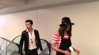 Alex Turner And Arielle Vandenberg Talk About One Direction As They Depart At LAX Airport