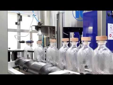 Youtube video of a whisky corking & labeling machine