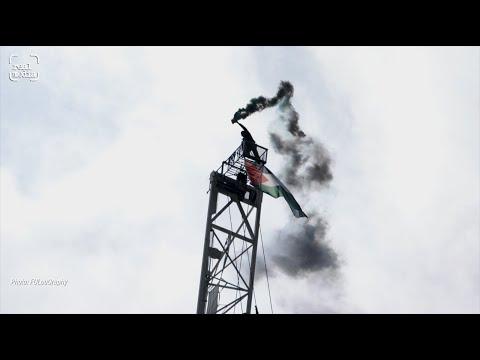 Solo Palestine solidarity crane protest high above London