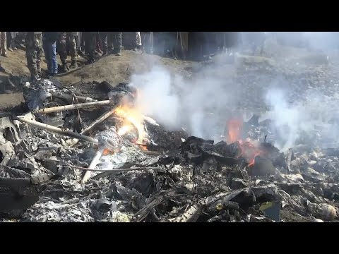 Flames rose from the wreckage of a crashed Indian aircraft Wednesday in Budgam, Indian-controlled Kashmir. (Feb. 27)