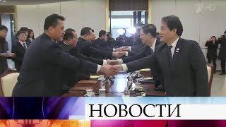 Политологи комментируют, благодаря кому стали возможны переговоры КНДР и Южной Кореи.