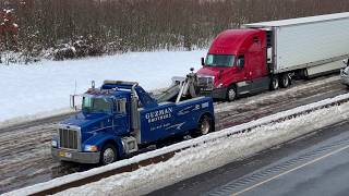 Trucks moving slowly over ice and snow on I-84