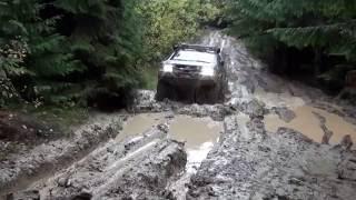 Mitsubishi L200 in deep mud. Off Road 4x4 in Ukrainian Carpathian