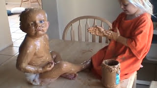 Sister Covers Baby Brother in Peanut Butter