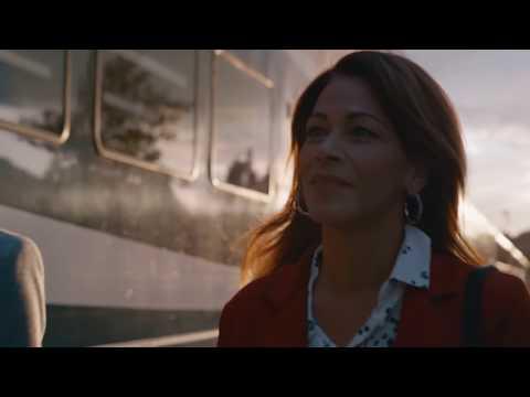 Lady alongside a Rocky Mountaineer train