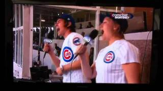 Will and Marika of Arcade Fire sing 7th inning stretch @ Cubs game 4/23/11